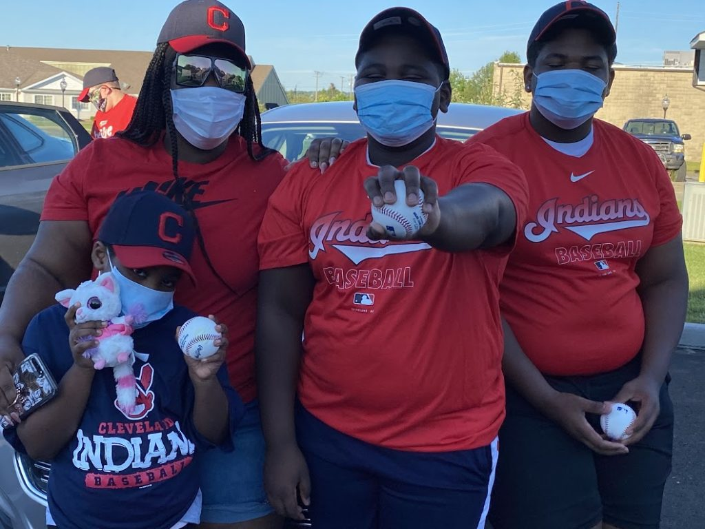 Family of 4 wearing their Indians gear at the Brad Hand game watch party